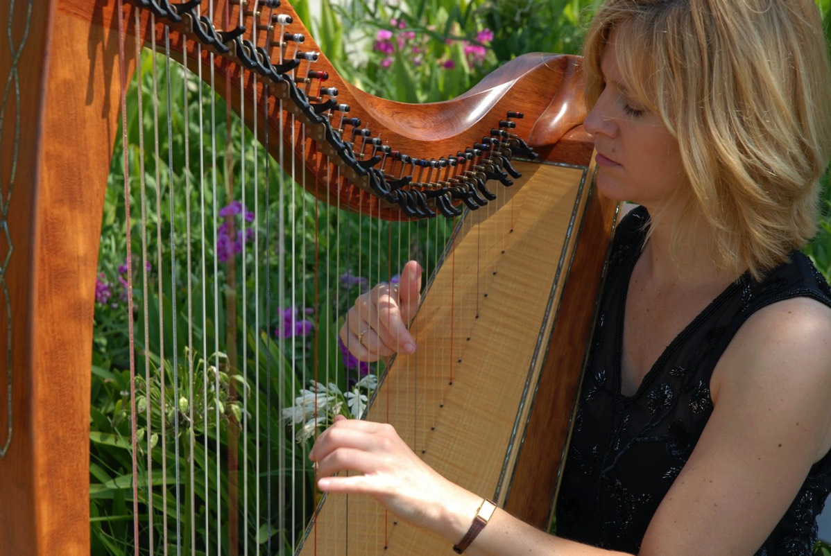 Harpist plays in rose garden, Santa Barbara, CA