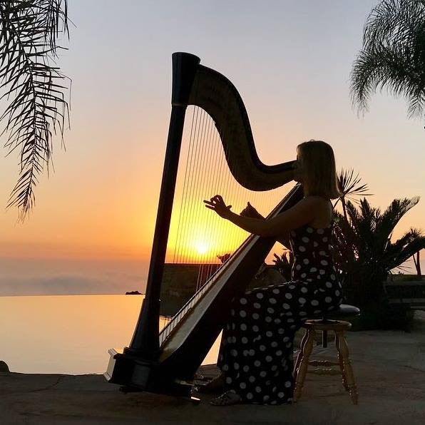 Harpist playing at sunset